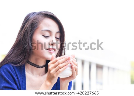 beautiful young asian woman enjoy drinking coffee - black and white - stock photo