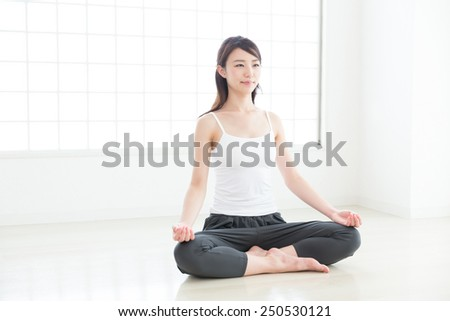 Beautiful young asian woman exercising in the room - stock photo