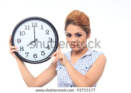 Beautiful young asian woman hold a clock show time at eight o clock isolated white background