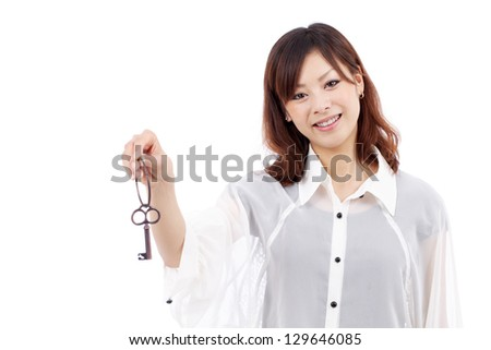 Beautiful young asian woman holding keyring in her hand isolated on white background