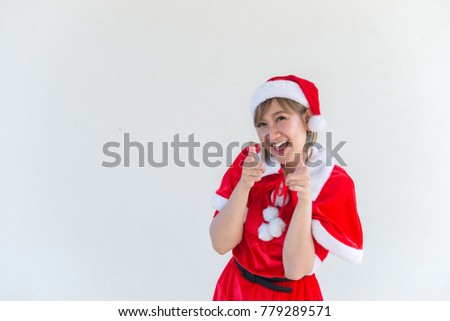 Beautiful young asian woman in Santa Claus clothes on white background,Thailand people,Sent happiness for children,Merry christmas,Welcome to winter,Happy woman concept