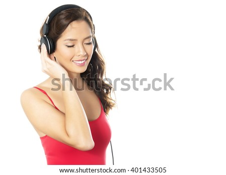 beautiful young asian woman listening to music with headphones isolated on white - stock photo