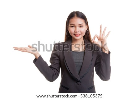 Beautiful young Asian woman show palm hand and OK sign  isolated on white background.