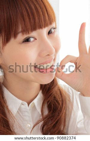 Beautiful young Asian woman smiling - stock photo