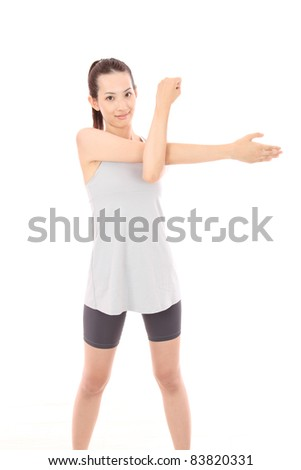 Beautiful young Asian woman stretching - stock photo