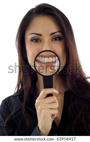 Beautiful young Asian woman teeth and magnifying glass isolated over white background - stock photo