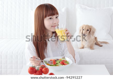 Beautiful young Asian woman to eat vegetables - stock photo