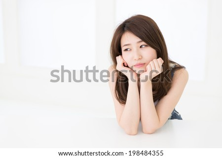 Beautiful young asian woman who gets tired - stock photo