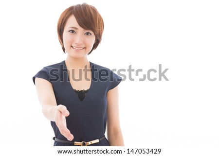 Beautiful young asian woman who shakes hands - stock photo