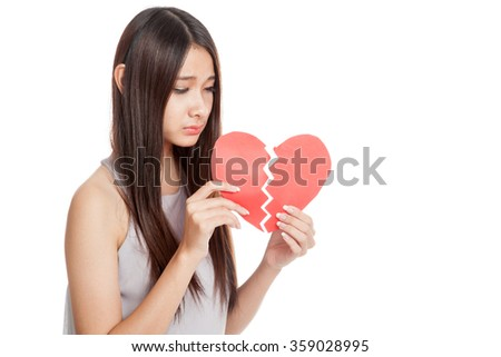 Beautiful young Asian woman with broken heart  isolated on white background - stock photo