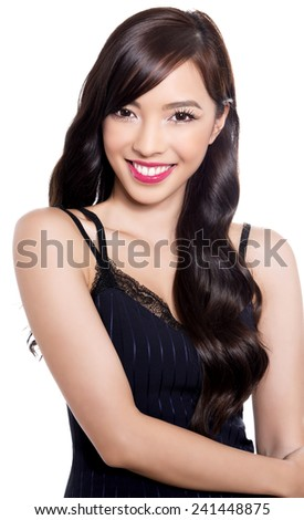 beautiful young asian woman with perfect skin posing on isolated background - stock photo