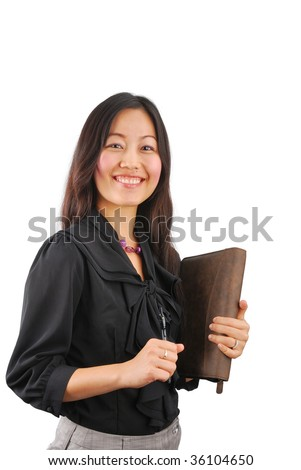 Beautiful young Asian woman with personal organizer - stock photo