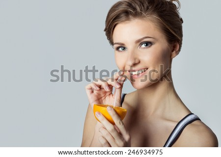 beautiful young athletic girl energetic happy drinking orange juice, healthy lifestyle - stock photo