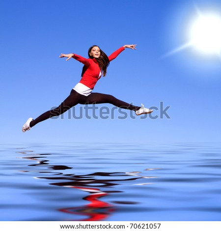 Beautiful young athletic woman jumping high - stock photo