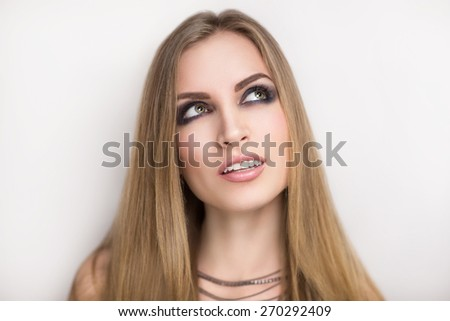 Beautiful young, attractive girl, star, model, rock singer, celebrity. Concert, disco.  Dream, desire, success, fame, fortune. Perfect face, flawless makeup, skin, expressive smoky eyes, natural lips. - stock photo