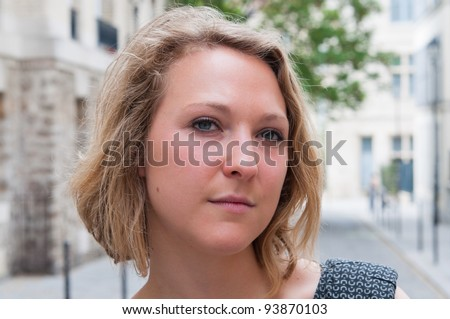 beautiful young attractive woman outdoors portrait of thinking woman - stock photo