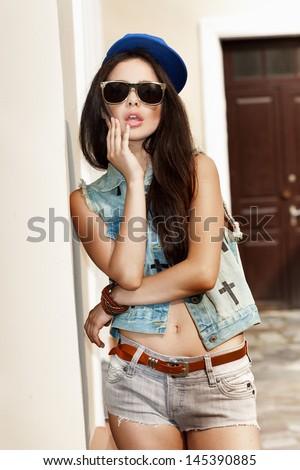beautiful young bad girl, outdoors - stock photo