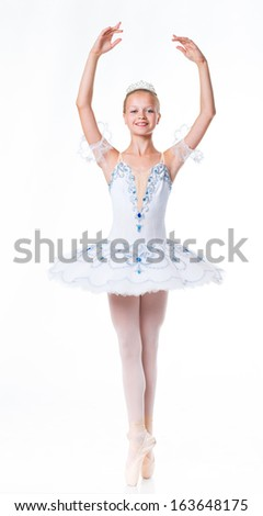 Beautiful young ballerina in classical tutu on a white background - stock photo