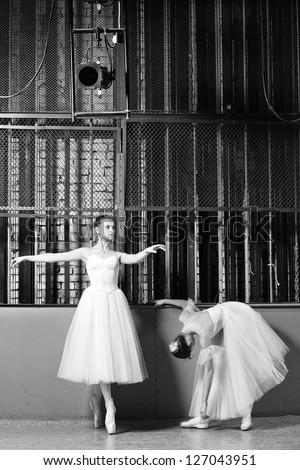 Beautiful Young ballet dancers in rehearsal. Black and white. - stock photo