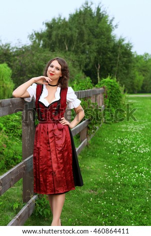 Beautiful, young, Bavarian woman in dirndl in village