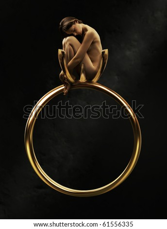 Beautiful young beauty in a golden ring - stock photo