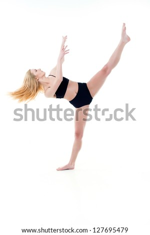 Beautiful young belly dancer, modern ballet. young and beautiful dancer posing on studio background - stock photo