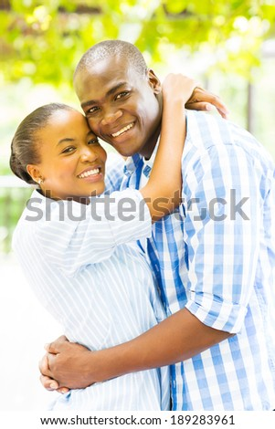 beautiful young black couple hugging