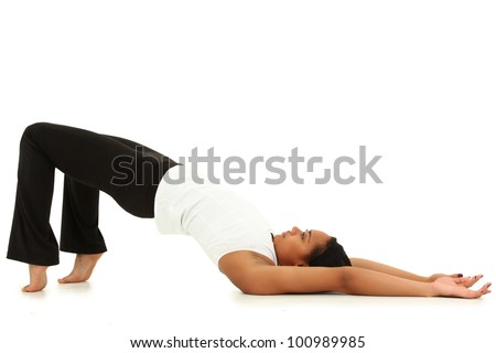 Beautiful Young Black Woman Doing Yoga Over White Background Barefoot in Sportswear - stock photo