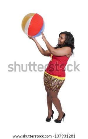 Beautiful young black woman holding a beach ball - stock photo