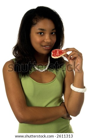 Beautiful young black woman holding a heart shaped Valentine's Day cookie - stock photo