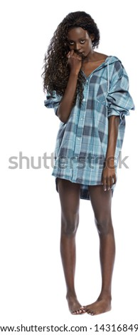 Beautiful young black woman in a mans plaid shirt flirts with the camera while isolated on a white background. - stock photo