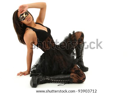 Beautiful Young Black Woman in Mardi Gras Mask over white background. - stock photo