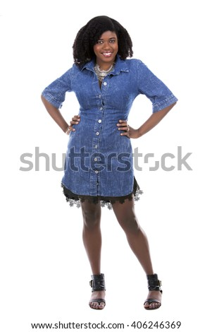 beautiful young black woman is wearing jean dress on white background - stock photo
