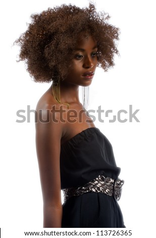 Beautiful young black woman isolated on a white background with short curly hair. - stock photo