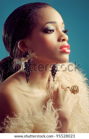 Beautiful young black woman with dark eye makeup and red lips, classic retro style look, closeup shot - stock photo