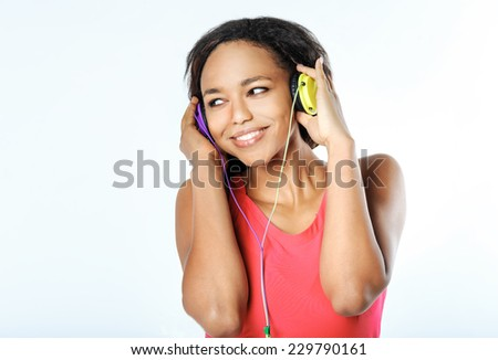 beautiful young black woman with headphones - stock photo