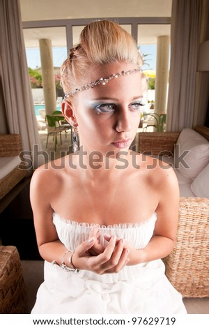 Beautiful young blond bride waiting - stock photo