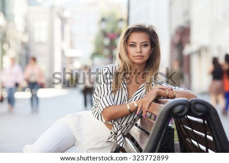 Beautiful young blond girl outdoors - stock photo
