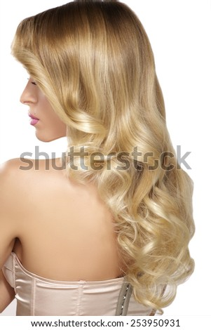 Beautiful young blond model curly hair posing on white - stock photo