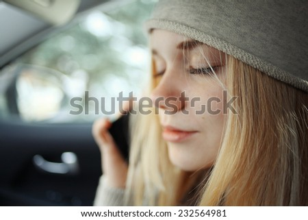 beautiful young blond teen in the car