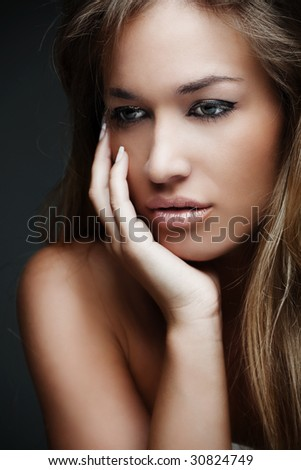 beautiful young blond woman - stock photo