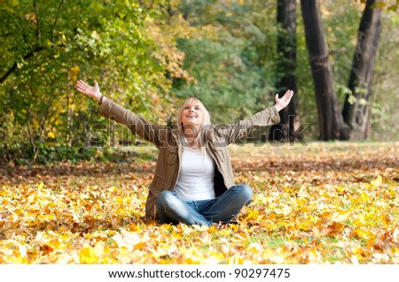 beautiful young blond woman cheering - stock photo