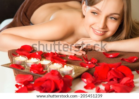 Beautiful young blond woman getting spa massage - stock photo
