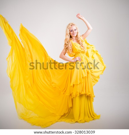 http://thumb7.shutterstock.com/display_pic_with_logo/1008140/328013039/stock-photo-beautiful-young-blond-woman-girl-is-in-a-bright-yellow-dress-floating-growing-flying-aircraft-328013039.jpg