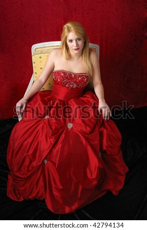beautiful young blond woman in red evening dress