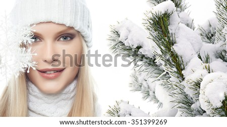 beautiful young blond woman in warm clothing isolated  on white christmas tree snow covered new year