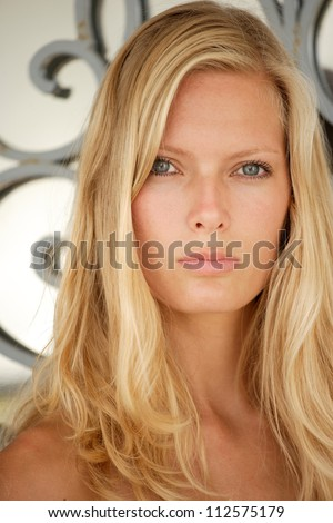 Beautiful young blond woman outdoor portrait.
