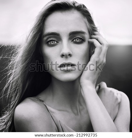 Beautiful young blond woman outdoors black and white portrait  - stock photo
