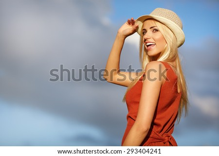 Beautiful young blond woman outdoors portrait