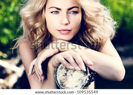 beautiful young blond woman outdoors.  Sunny day - stock photo